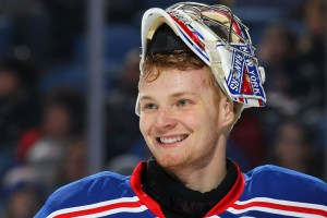 BUFFALO, NY - FEBRUARY 20: Mackenzie Skapski #70 of the New York Rangers, playing in his first NHL game, flashes a smile during their game against the Buffalo Sabres on February 20, 2015 at the First Niagara Center in Buffalo, New York. New York won, 3-1. (Photo by Bill Wippert/NHLI via Getty Images)