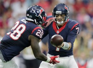 Houston Texans' Brian Hoyer (7) hands off to Alfred Blue (28) against the San Francisco 49ers during an NFL preseason football game, Saturday, Aug. 15, 2015, in Houston. (AP Photo/Patric Schneider)