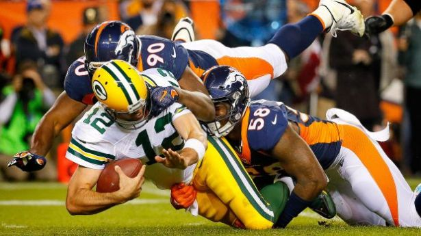 aaron-rodgers-green-bay-packers-sacked-denver-broncos.vadapt.620.high.52