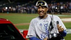 Salvador Perez poses with his trophy after being named the MVP of the Major League Baseball World Series. (AP Photo/Matt Slocum)
