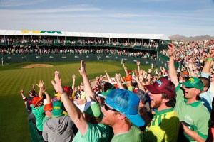 SCOTTSDALE, AZ - FEBRUARY 2: Fans cheer Phil Mickelson's near hole-in-one on the 16th hole during the third round of the Waste Management Phoenix Open at TPC Scottsdale on February 2, 2013 in Scottsdale, Arizona. (Photo by Hunter Martin/Getty Images)