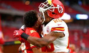 Aug 15, 2015; Glendale, AZ, USA; Kansas City Chiefs defensive back Eric Berry (29) hugs his mother Carol Berry prior to the game against the Arizona Cardinals in a preseason NFL football game at University of Phoenix Stadium.