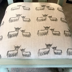 Hand-printed Highland Coo Fabric on chair by Clement Design