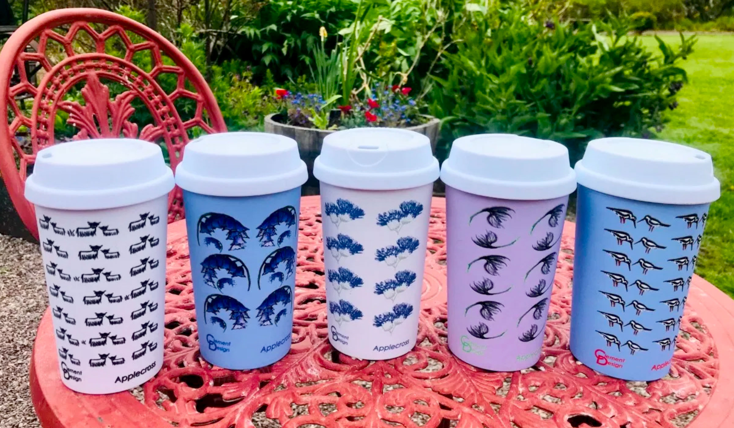Highland Coo Thistle Bluebells Cotton Grass Oyster Catchers Travel Mugs by Clement Design