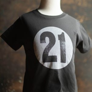 Image of kid's shirt, white 21 on a black shirt