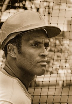 Circa 1972 Roberto Clemente stands in front of the netting for the batting cages.