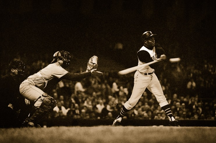 Roberto Clemente is caught mid-swing during a night game at Forbes Field in 1968/69