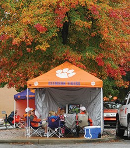 You'll find all the comforts of home in some tailgating tents, including TVs to keep up with the day's scores.