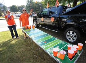 When the game is over, the party keeps going, with cornhole games and beverages.