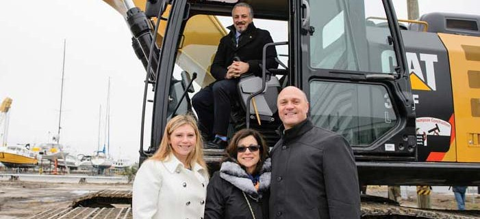Laura Zucker, Anita Zucker and President Clements in front of Jonathan Zucker at the ground breaking.