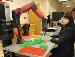Sophia Wang works with a robotic arm in her lab.
