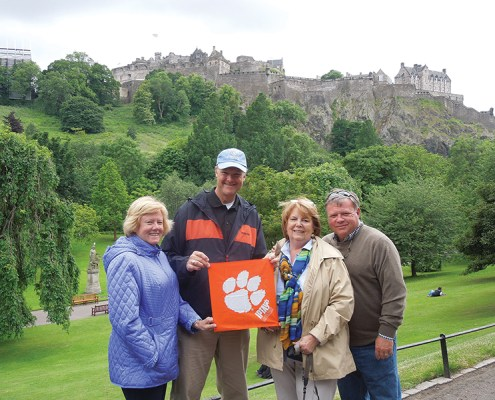 Scotland *Kathy Davis '76 and *David Sudduth '90, M '98 proudly show their Tiger Rag in beautiful Edinburgh with Stephanie and Mike Taylor '76, M '78.