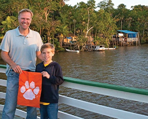 Brazil *Jon '93 and *Hans Payne bring their Clemson spirit to the Amazon River in Belém.