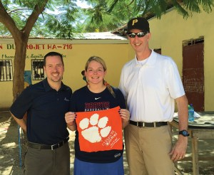 Haiti Andy Russell '99, Rustin Cassels '12 and Rob Porter '93 display a Tiger Rag while on a mission trip with Compassion International.
