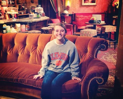 "California Shelley Neal '15 displays her Clemson pride on the set of ""Friends"" at the Warner Brothers Studio in Burbank."