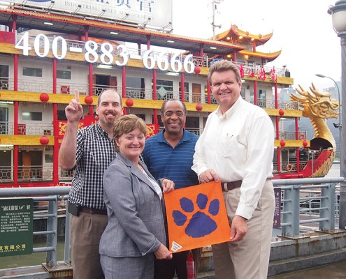 China Stan Jablonski '05, June Opitz Satterfield '82, Fritz Moise Jr. '90 and *Ty Cobb Jr. '79 made sure to take their Clemson pride with them on their business trip to China.