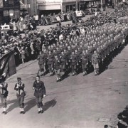 The 32nd Red Arrow Division marches in a 4th of July parade in Adelaide, South Australia, 1942.