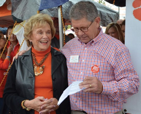 Jane Duckworth receives a certificate naming her an honorary alumna from Danny Gregg, president of the Alumni Association board.