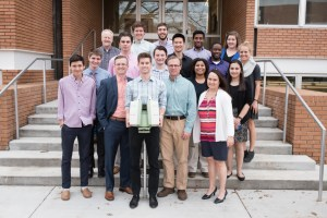 Morgan Corp. officials donated a LiDAR scanner and then posed for photos with students, who used it during their trip to Dominica.