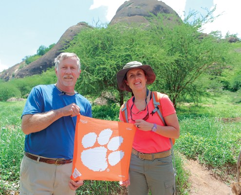 Walley Turner '69 and Sally Walker Tucker '99 of Chapin share their Tiger pride in Kenya while visiting the Mully Children's Family while on a mission trip with their church.