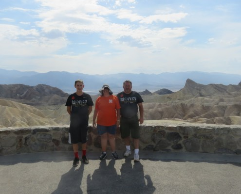 Ron Arias '87 with his wife Liz and son Ron Jr. visited the other Death Valley in California. Zabriskie Point and Manly Beacon can be seen to the right of the family.