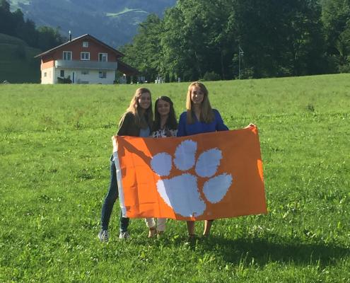 Whitney Sanders '01 and company showing her Tiger pride in Switzerland.