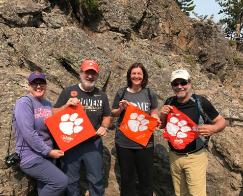 Toni Seals, Mike Seals '85, Anne Weldon Zarbock '88 and Jeff Gallaher '78 brought their Clemson orange to the Upper Falls of the Yellowstone River in Yellowstone National Park.