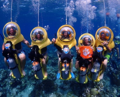 Honduras: Dawn Berndt M '16 explores the amazing reefs off the coast of Roatán with her family — on underwater BOSS scooters.