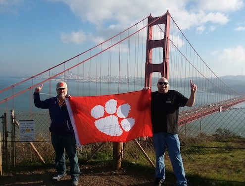 California: Harry Childs '89, right, and Oscar Outen rep the Tigers in San Francisco during a trip to see the National Championship.