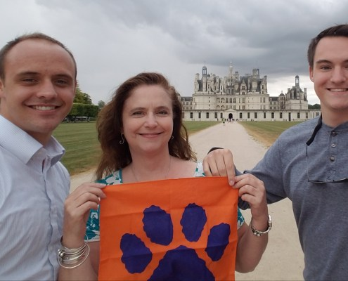 France: Elizabeth Milam '87, M '88 with her sons, Carson Lomas, a first lieutenant in the U.S. Air Force, and Turner Lomas '20, at the Chateau de Chambord. Milam, director of student financial aid, celebrated her 30th year working at the University in Dec. 2018.