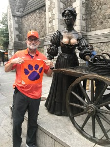 """Ireland: David Berry '76 in downtown Dublin posing with the famous """"Molly Malone"""" statue."""