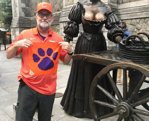 "Ireland: David Berry '76 in downtown Dublin posing with the famous ""Molly Malone"" statue."