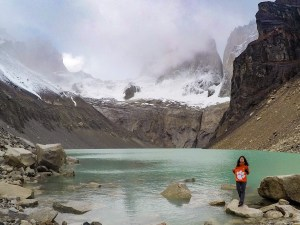"Chile: Piyusha Khanna '16 took a solo backpacking trip in the Chilean Patagonia region in December 2019 to complete the W Trek. ""This was on the last day. I started at 3:30 in the morning to reach the base of the towers by sunrise, but the weather got really bad,"" Khanna wrote. ""I, along with a couple of other early hikers, sat under a huge rock for over 2 hours while it was raining. The struggle made us appreciate and enjoy the views even more!"""
