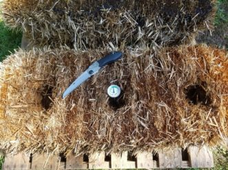 Small hand saws work well for cutting divots into a bale for planting.