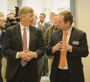 J. Curtiss Fox (right) chats with U.S. Secretary of Energy Daniel Poneman at the dedication of the SCE&G Energy Innovation Center.
