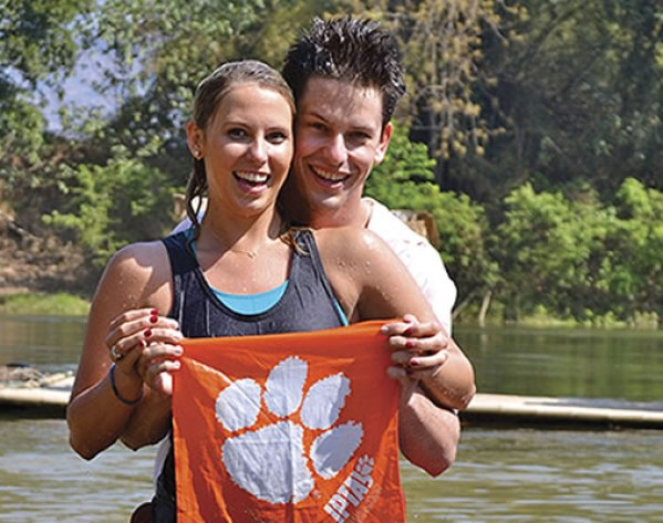 Thailand Hunter Wilson '11 and Kelly Walker '11 enjoy a ride in the Kwai River on an elephant reserve outside of Bangkok.