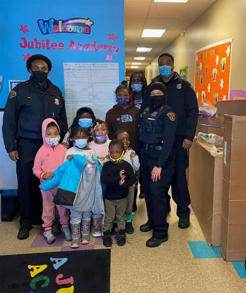 5th district provides coats for kids at Jubilee Academy