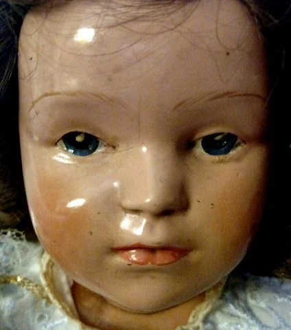 Creepy old doll face