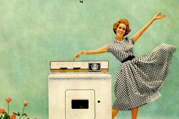 Happy housewife with a Maytag washer in 1959