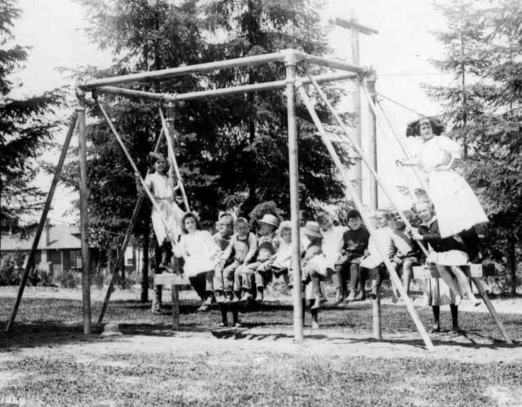 Old playground from 1912 with sideways swing