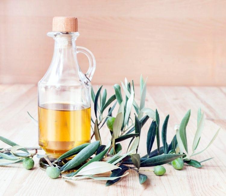 Glass bottle of olive oil.