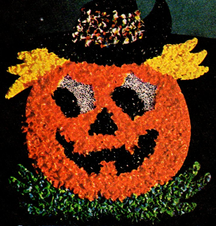Retro glittering, glowing Halloween Jack O'Lantern bead decoration (1974)