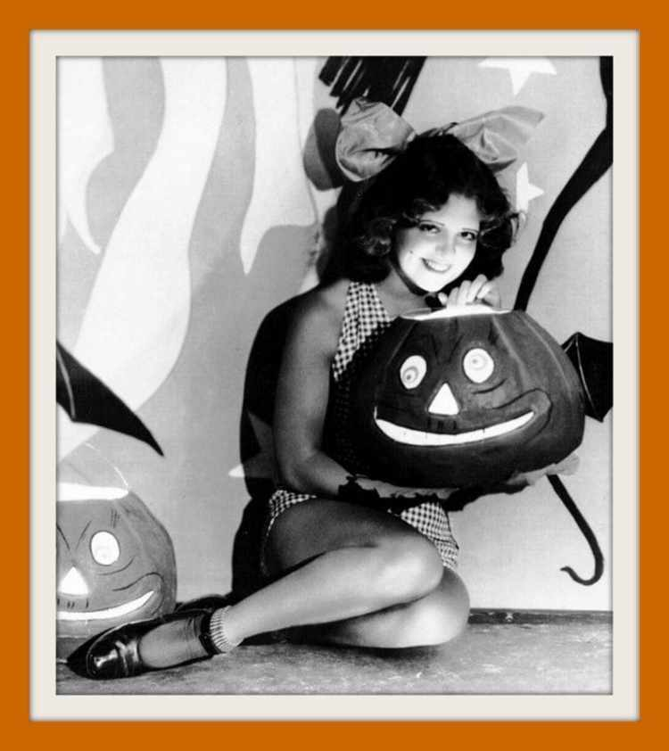 Silent film actress Clara Bow posing for for Halloween