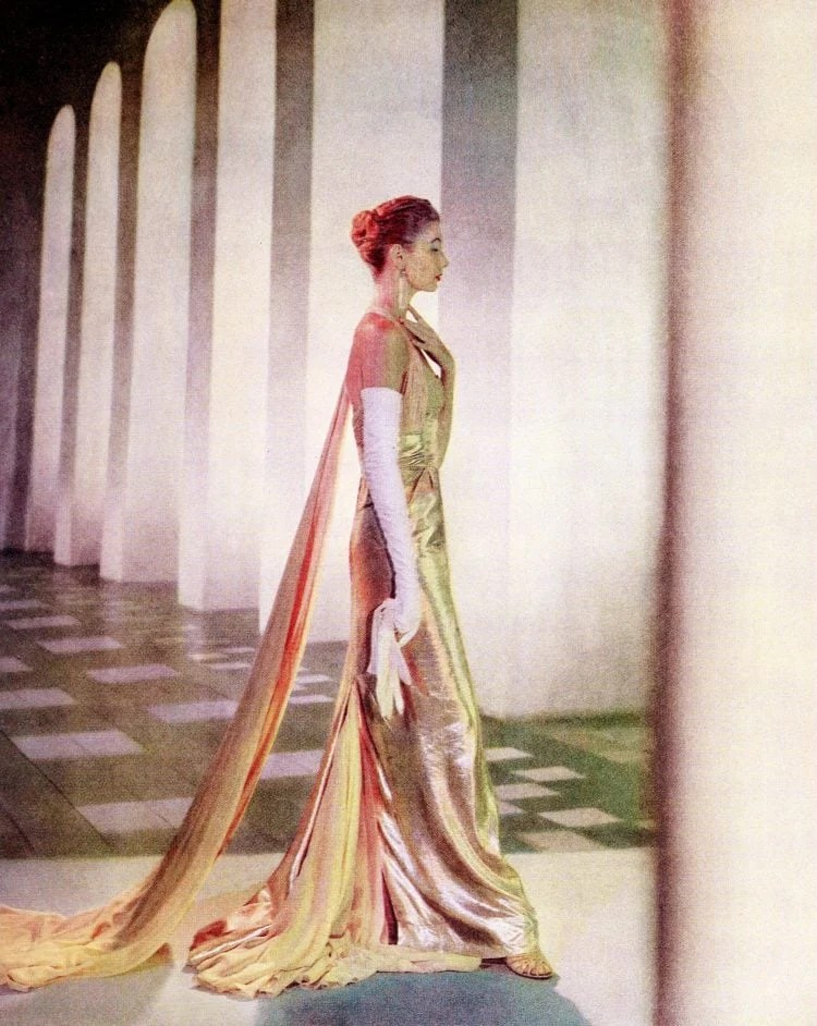 Super slender model with beautiful gold evening dress from the 1950s
