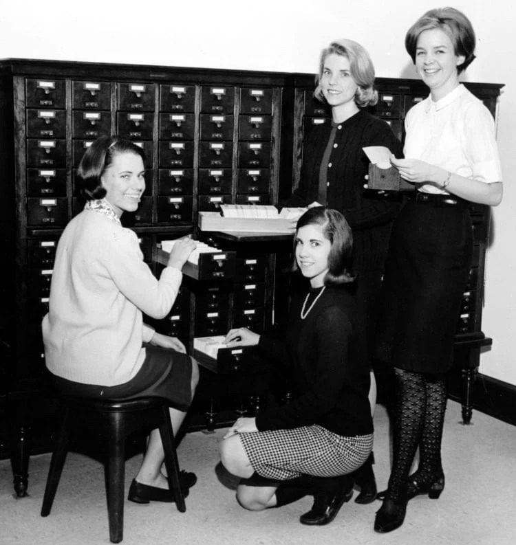Sweet Briar College students standing by the library card catalog, 1967