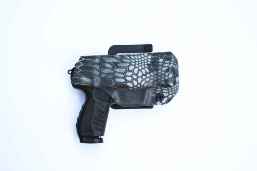 Shuko outside the waist band (OWB) kydex holster made by click holsters