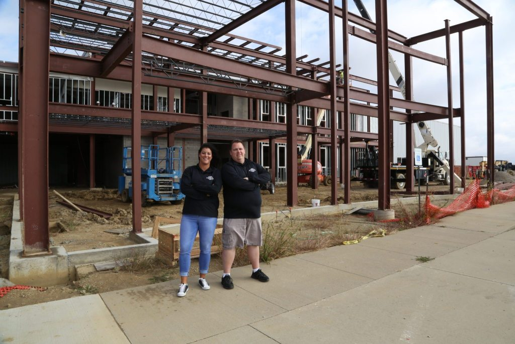 Lacy and Bill stand in front of the new Clickstop Building Construction