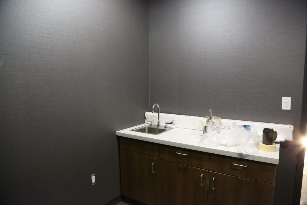 The therapy room has a nice calming grey color to help relax employees.