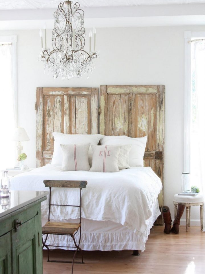 shab chic bedroom with door wooden headboard