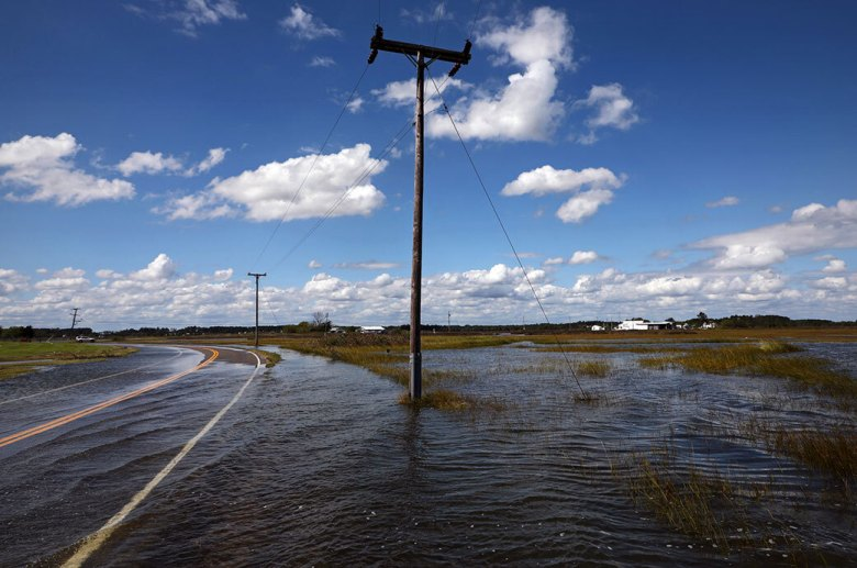"""Rising seas will exacerbate problems that             coastal communities are already dealing with, including             high-tide, or """"nuisance,"""" floods. Inundated roadways like             this one in Virginia are among the consequences of such             floods. Credit: Aileen Devlin, Virginia Sea Grant License"""